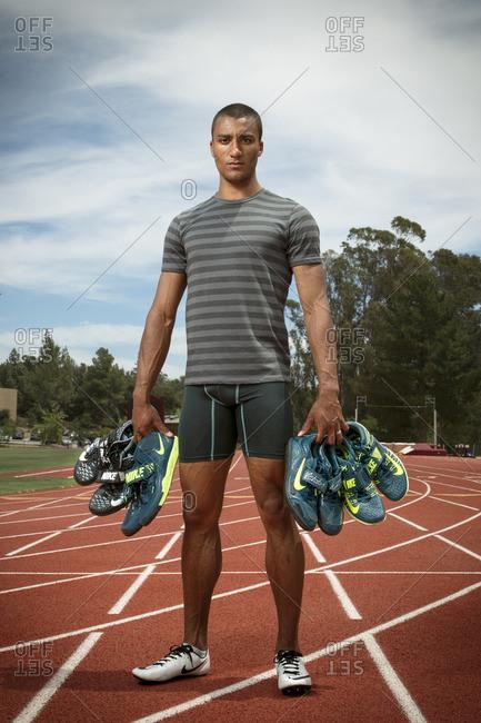 April 30, 2015: Olympic Athlete Ashton Eaton holding shoes