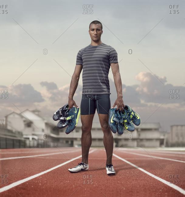 April 30, 2015:Olympic Athlete Ashton Eaton holding shoes