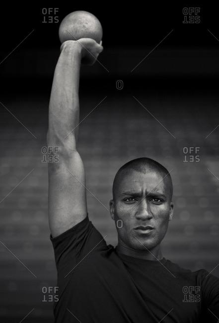 May 6, 2015: Olympic Athlete Ashton Eaton holding up shot-put