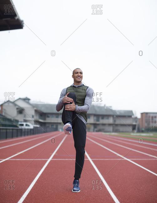 February 7, 2016: Olympic Athlete Ashton Eaton smiling and stretching