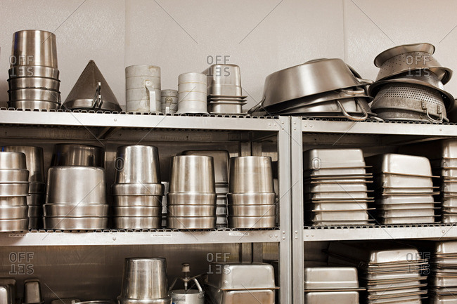 Kitchen utensils and baking tins in a commercial kitchen