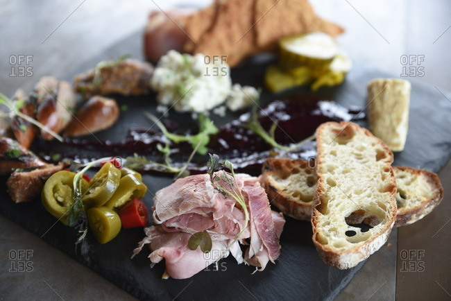 Charcuterie board with a variety of bread, meats and cheeses