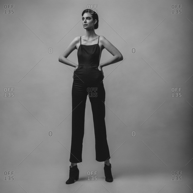 Tall woman wearing black jumpsuit
