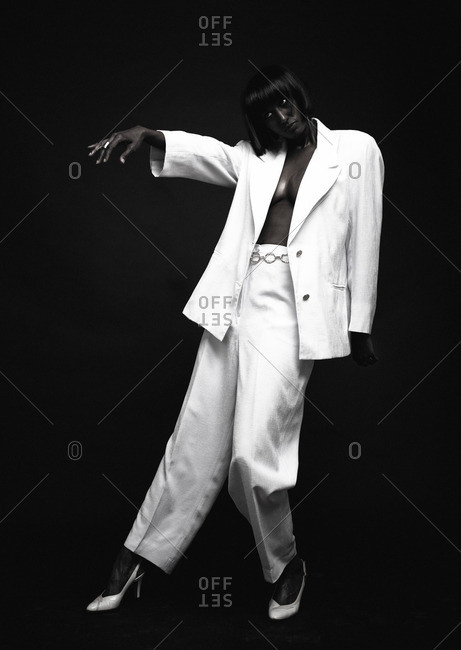 Woman wearing white suit with exposed cleavage