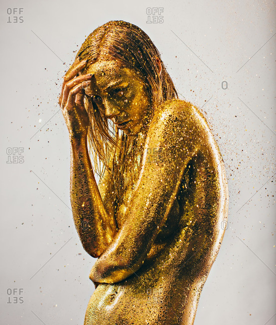 February 6, 2016: Woman covered in gold glitter