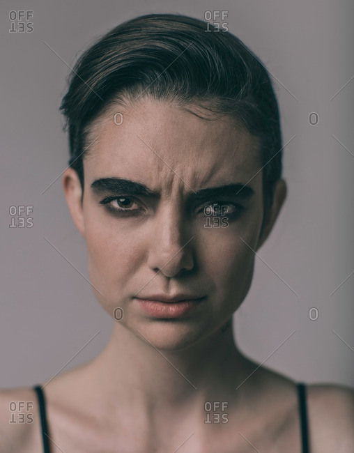 Brunette woman with a confused expression
