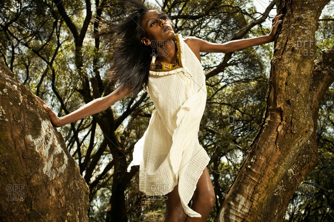 April 23, 2012: Woman in white dress in a tree