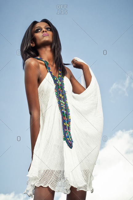 April 23, 2012: Woman in white dress in front of cloudy sky