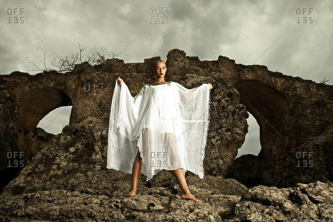 April 28, 2012: Woman wearing white outfit by rock formation