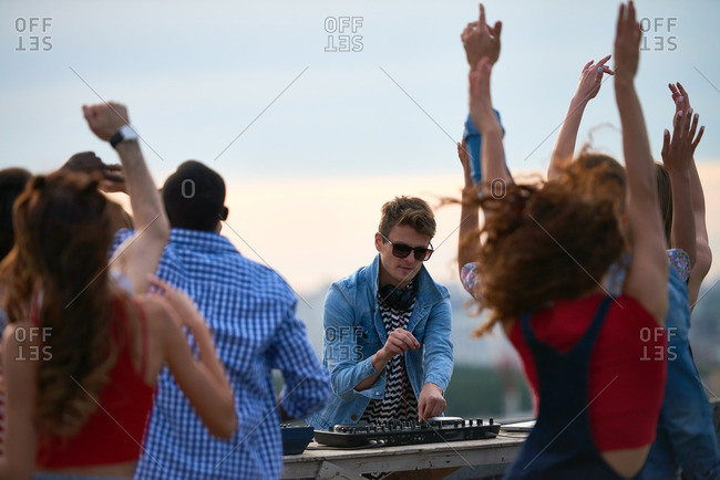 DJ working at rooftop party