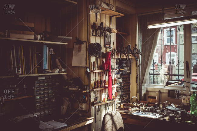 Old horologists workshop with clock repairing tools, equipment and book