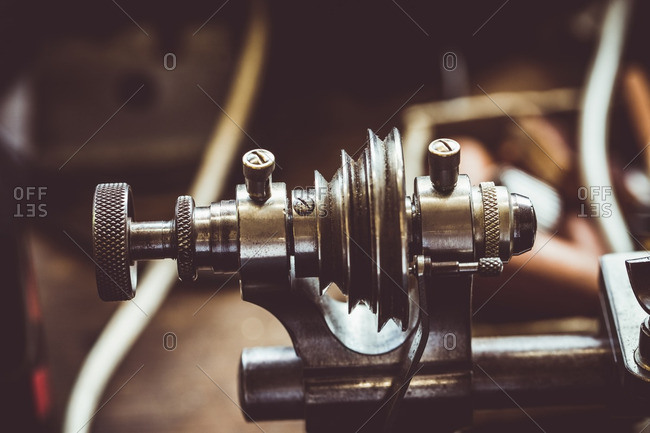 Close-up of old horological milling machine part in workshop