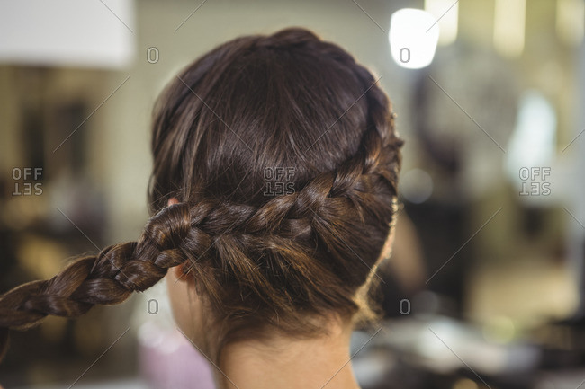Rear view of woman with braids hairstyle at a salon