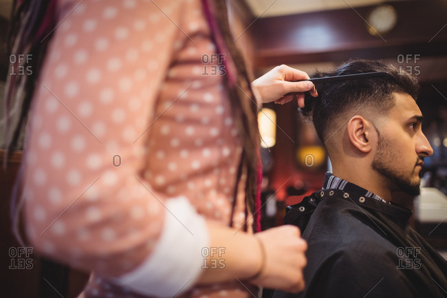 Man getting his hair trimmed in barber shop
