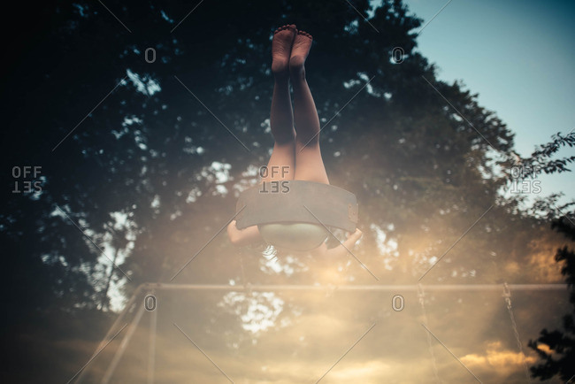 Bare legs of child swinging