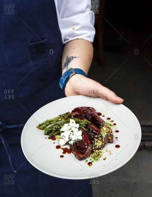 Oslo, Norway - June 27, 2016: Norwegian Mink Whale dish at Bon Lio restaurant, Oslo, Norway