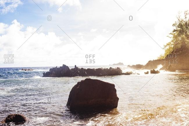Sun dappled rocky coast area