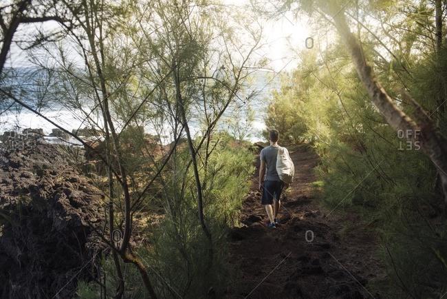 Man on remote coastal path