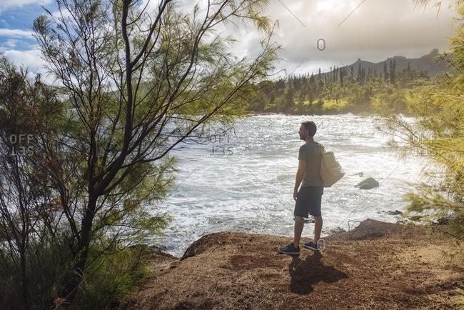Man exploring remote coastal area