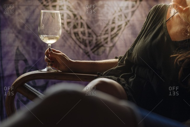 Woman lounging with glass of wine