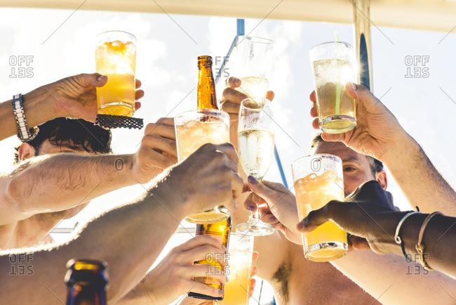 Friends toasting in beach setting