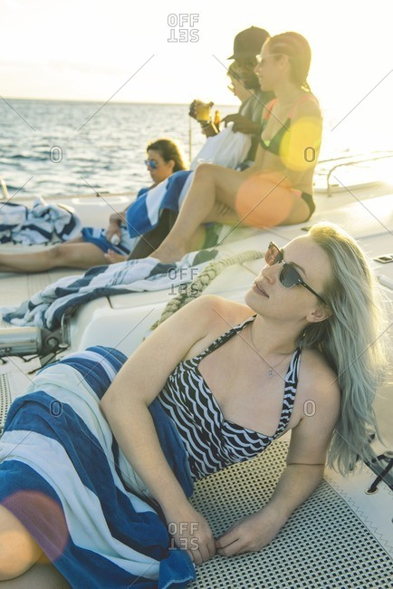 Woman and friends lounging on boat