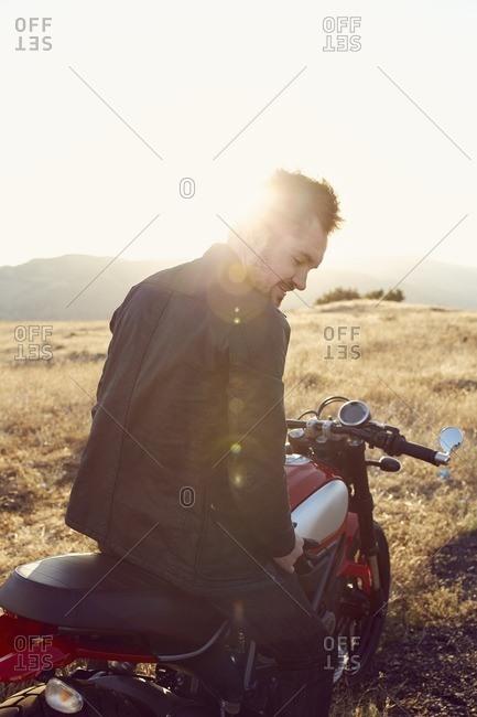 Man on motorbike in rural setting
