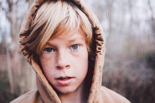 Blonde Boy Wearing Hooded Jacket Outside Stock Photo Offset