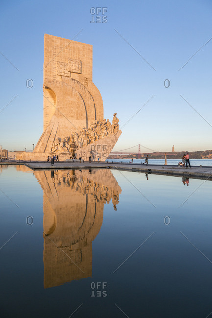 Lisbon, Portugal - July 8 2015: Sunset on the Padrao dos Descobrimentos (Monument to the Discoveries) reflected in Tagus River, Belem, Lisbon, Portugal, Europe