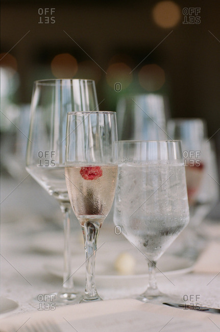 Glasses with water and champagne at a wedding reception