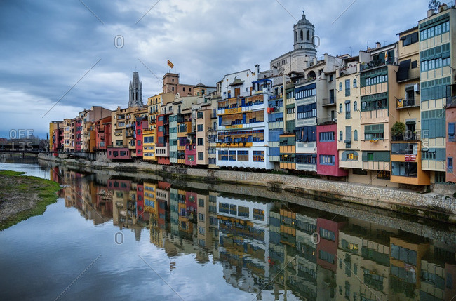 Colorful building along a placid waterfront