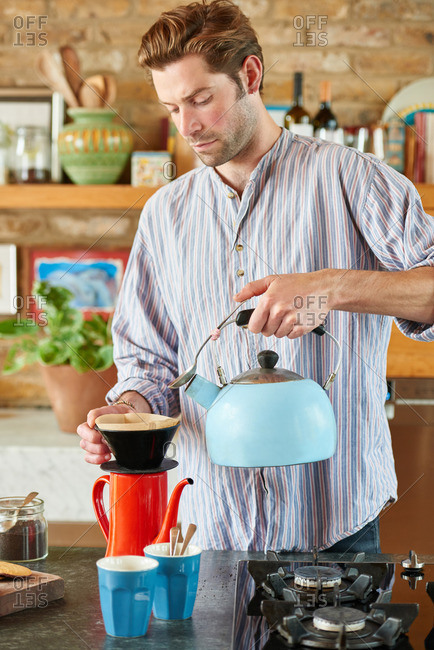 Man using the pour over method to make coffee