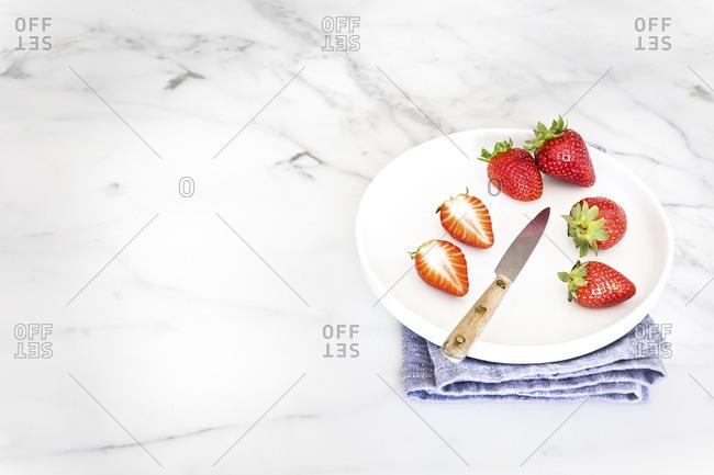 Plate of sliced strawberries