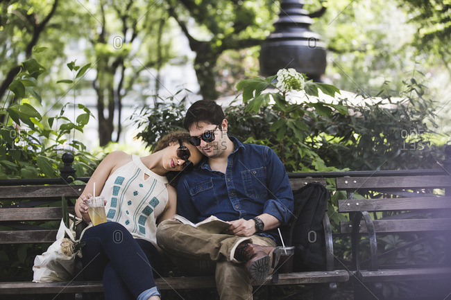 Young couple on city bench