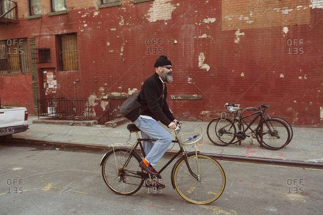 Man with beard on bike