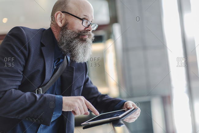 Bearded businessman with tablet