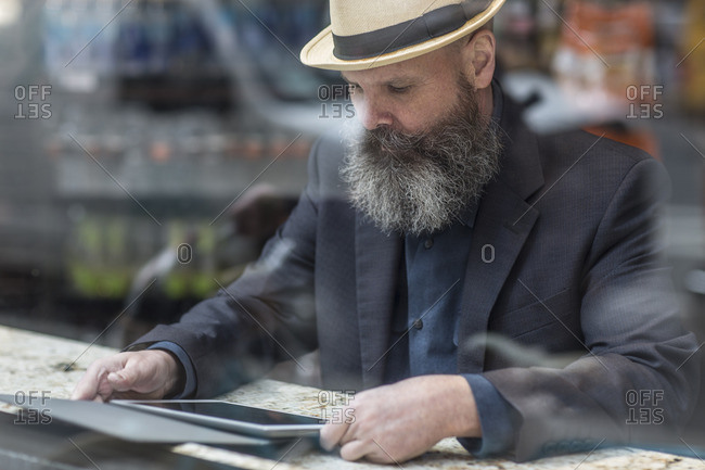 Bearded man using a tablet