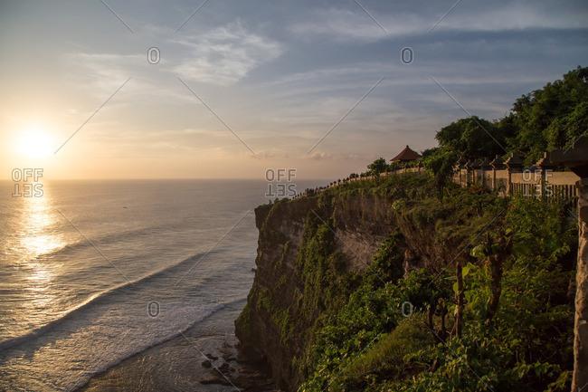 Cliff trail over sunlit ocean