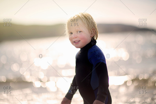 Boy with wet hair wearing wetsuit, portrait