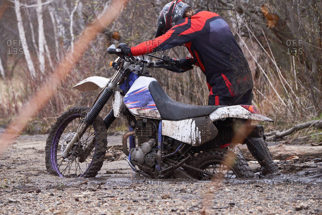 Man riding motorcycle in dirt
