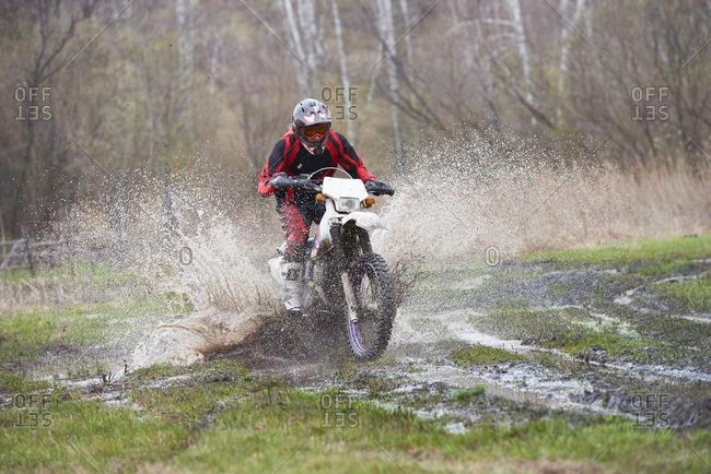 Motocross rider racing in mud track