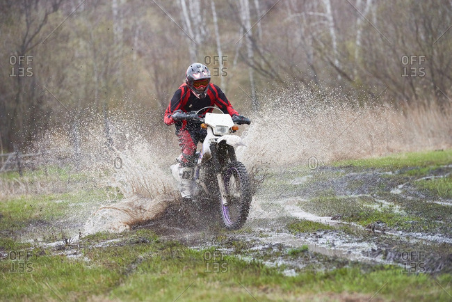 Motocross rider racing in mud track
