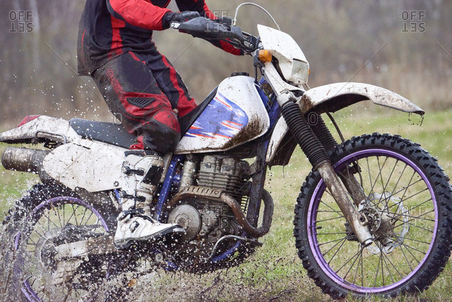Motorcyclist racing in mud