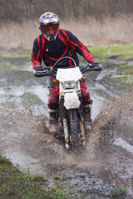 Extreme motocross racing on mud track