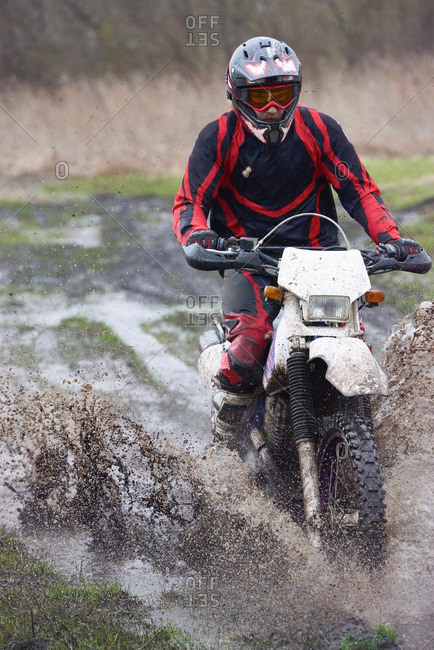 Extreme motocross racing in a rural field