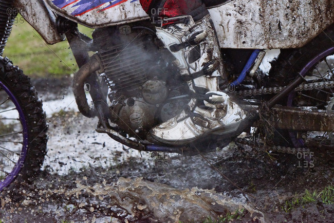 Motorcycle splattered in mud