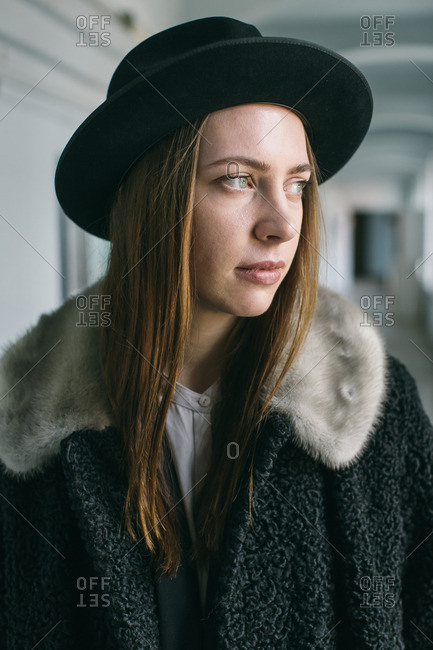 Portrait of young woman with black hat and fuzzy jacket