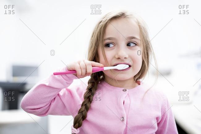 Girl brushing teeth, close-up