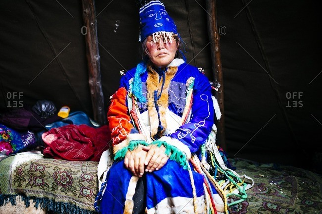 Mongolia - July 12, 2016: A Tsaatan woman in traditional shaman dress in the East Taiga in northern Mongolia