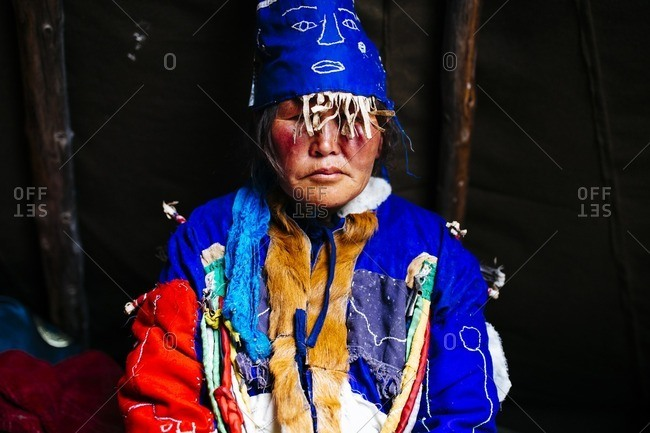 Mongolia - July 12, 2016: Portrait of a Tsaatan woman in traditional shaman dress in the East Taiga in northern Mongolia